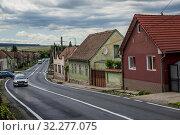 Купить «Examples of traditional Saxon residential architecture in Miercurea Sibiului town of Sibiu County in southern Transylvania, Romania.», фото № 32277075, снято 7 июля 2016 г. (c) age Fotostock / Фотобанк Лори