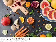 Купить «different vegetables and fruits on on slate table», фото № 32278451, снято 5 апреля 2018 г. (c) Syda Productions / Фотобанк Лори