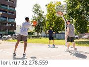 Купить «group of male friends playing street basketball», фото № 32278559, снято 21 июля 2019 г. (c) Syda Productions / Фотобанк Лори