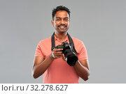 Купить «indian man or photographer with digital camera», фото № 32278627, снято 8 сентября 2019 г. (c) Syda Productions / Фотобанк Лори
