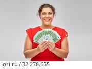 Купить «happy woman holding hundreds of money banknotes», фото № 32278655, снято 15 сентября 2019 г. (c) Syda Productions / Фотобанк Лори
