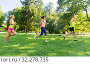 Купить «happy young sportsmen racing wit badge numbers», фото № 32278735, снято 16 августа 2015 г. (c) Syda Productions / Фотобанк Лори
