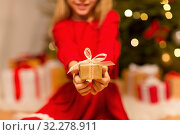 Купить «close up of girl with christmas gift at home», фото № 32278911, снято 22 декабря 2017 г. (c) Syda Productions / Фотобанк Лори