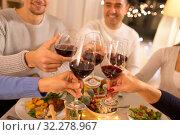 Купить «happy family having dinner party at home», фото № 32278967, снято 15 декабря 2018 г. (c) Syda Productions / Фотобанк Лори