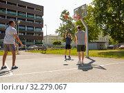 Купить «group of male friends playing street basketball», фото № 32279067, снято 21 июля 2019 г. (c) Syda Productions / Фотобанк Лори