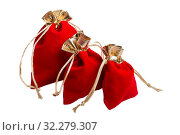 Купить «Red velvet gift pouch with gold trim. Three bags of different sizes isolated on white background», фото № 32279307, снято 10 октября 2019 г. (c) Юлия Бабкина / Фотобанк Лори