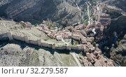 Купить «Aerial view of Albarracin - medieval town with fortress wall on hillside, Spain», видеоролик № 32279587, снято 26 декабря 2018 г. (c) Яков Филимонов / Фотобанк Лори