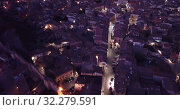 Купить «Evening aerial view of medieval Spanish town of Daroca with gate Puerta Baja on main city street», видеоролик № 32279591, снято 9 марта 2019 г. (c) Яков Филимонов / Фотобанк Лори