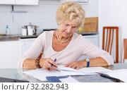 Купить «Woman put in order documents», фото № 32282943, снято 11 июля 2018 г. (c) Яков Филимонов / Фотобанк Лори