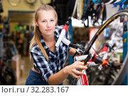 worker is standing near bicycle and cheking wheels. Стоковое фото, фотограф Яков Филимонов / Фотобанк Лори