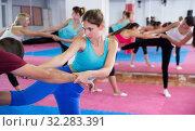 Young woman practicing box fighter with coach. Стоковое фото, фотограф Яков Филимонов / Фотобанк Лори
