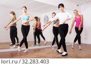 Купить «Ordinary active females exercising dance moves», фото № 32283403, снято 21 сентября 2019 г. (c) Яков Филимонов / Фотобанк Лори