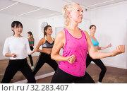 Купить «Ordinary active females exercising dance moves», фото № 32283407, снято 21 сентября 2019 г. (c) Яков Филимонов / Фотобанк Лори
