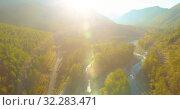 Купить «Low altitude flight over fresh fast mountain river with rocks at sunny summer morning.», видеоролик № 32283471, снято 6 апреля 2019 г. (c) Александр Маркин / Фотобанк Лори