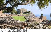Купить «Mass tourism in the ancient Greek amphitheater, Taormina, Ionian Sea view», видеоролик № 32283999, снято 17 мая 2019 г. (c) Ирина Мойсеева / Фотобанк Лори