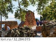Купить «tourists near the dilapidated walls of the amphitheater, Taormina, Ionian Sea», фото № 32284015, снято 17 мая 2019 г. (c) Ирина Мойсеева / Фотобанк Лори