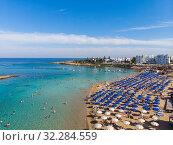 Купить «Protaras, Cyprus - Oct 11. 2019 The Famous fig tree beach of city», фото № 32284559, снято 11 октября 2019 г. (c) Володина Ольга / Фотобанк Лори