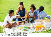 Купить «Couple with children at picnic», фото № 32285127, снято 18 ноября 2019 г. (c) Яков Филимонов / Фотобанк Лори