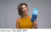 Купить «happy young woman with air ticket and passport», видеоролик № 32285591, снято 7 октября 2019 г. (c) Syda Productions / Фотобанк Лори