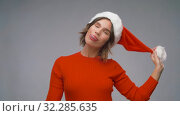 Купить «woman in santa helper hat having fun on christmas», видеоролик № 32285635, снято 7 октября 2019 г. (c) Syda Productions / Фотобанк Лори