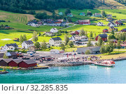 Купить «Small  houses at Olden, Norway.Olden is a village and urban area in the municipality of Stryn in Sogn og Fjordane county, Norway.», фото № 32285835, снято 26 мая 2020 г. (c) Николай Коржов / Фотобанк Лори