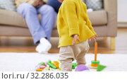 Купить «african baby girl playing with toy blocks at home», видеоролик № 32286035, снято 7 октября 2019 г. (c) Syda Productions / Фотобанк Лори