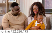happy african family with baby daughter at home. Стоковое видео, видеограф Syda Productions / Фотобанк Лори