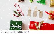 Купить «set of christmas gifts, tags and decorations», видеоролик № 32286307, снято 4 августа 2020 г. (c) Syda Productions / Фотобанк Лори