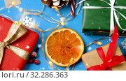 Купить «snowing over christmas gifts and decorations», видеоролик № 32286363, снято 13 ноября 2019 г. (c) Syda Productions / Фотобанк Лори