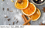 Купить «dried orange slices, clove, cinnamon and anise», видеоролик № 32286367, снято 22 октября 2019 г. (c) Syda Productions / Фотобанк Лори