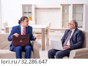 Купить «Two businessman discussing business in office», фото № 32286647, снято 19 июня 2019 г. (c) Elnur / Фотобанк Лори