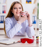 Купить «Dentistry student practicing skills in classroom», фото № 32288827, снято 19 февраля 2018 г. (c) Elnur / Фотобанк Лори