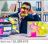 Купить «The businessman with reminder notes in multitasking concept», фото № 32289619, снято 26 сентября 2017 г. (c) Elnur / Фотобанк Лори