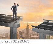 Купить «Businessman ready to overcome the broken bridge», фото № 32289675, снято 11 декабря 2019 г. (c) Elnur / Фотобанк Лори