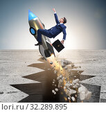 Купить «Businessman flying on rocket from rock gap», фото № 32289895, снято 5 июня 2020 г. (c) Elnur / Фотобанк Лори