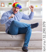 Купить «The funny man singing songs in karaoke at home», фото № 32290979, снято 29 марта 2017 г. (c) Elnur / Фотобанк Лори