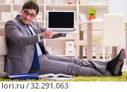 Купить «The businessman working on the floor at home», фото № 32291063, снято 10 февраля 2017 г. (c) Elnur / Фотобанк Лори