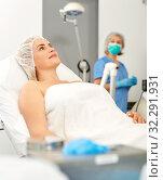 Купить «Young woman waiting for cosmetic procedure in clinic of esthetic cosmetology», фото № 32291931, снято 14 марта 2019 г. (c) Яков Филимонов / Фотобанк Лори