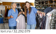 Купить «Two female dry-cleaning salon employees», фото № 32292079, снято 22 января 2019 г. (c) Яков Филимонов / Фотобанк Лори