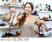 Купить «Cheerful woman shopping many shoes pairs», фото № 32292135, снято 20 февраля 2020 г. (c) Яков Филимонов / Фотобанк Лори
