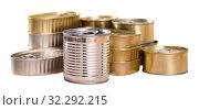 Купить «Unlabeled tin cans on table», фото № 32292215, снято 6 июля 2020 г. (c) Яков Филимонов / Фотобанк Лори