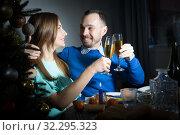 Купить «Happy couple celebrating Christmas», фото № 32295323, снято 15 января 2019 г. (c) Яков Филимонов / Фотобанк Лори
