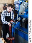 Male worker repairing shoe. Стоковое фото, фотограф Яков Филимонов / Фотобанк Лори