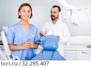 Купить «doctor with assistant are posing on workplace in hospital», фото № 32295407, снято 10 июля 2017 г. (c) Яков Филимонов / Фотобанк Лори
