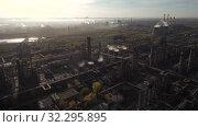 Купить «Стерлитамакский нефтехимический завод. Вид с воздуха. Sterlitamak petrochemical plant. Aerial view.», видеоролик № 32295895, снято 16 октября 2019 г. (c) Евгений Романов / Фотобанк Лори