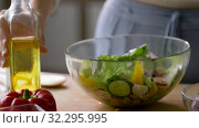 Купить «woman cooking vegetable salad with oil at home», видеоролик № 32295995, снято 10 октября 2019 г. (c) Syda Productions / Фотобанк Лори