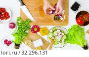 Купить «young woman chopping vegetables at home», видеоролик № 32296131, снято 10 октября 2019 г. (c) Syda Productions / Фотобанк Лори