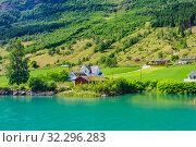Купить «Small  houses at Olden, Norway.Olden is a village and urban area in the municipality of Stryn in Sogn og Fjordane county, Norway.», фото № 32296283, снято 4 августа 2020 г. (c) Николай Коржов / Фотобанк Лори
