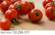Купить «red ripe cherry tomatoes in glass bowl», видеоролик № 32296311, снято 10 октября 2019 г. (c) Syda Productions / Фотобанк Лори