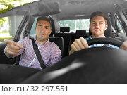 Купить «car driving school instructor teaching male driver», фото № 32297551, снято 25 августа 2019 г. (c) Syda Productions / Фотобанк Лори